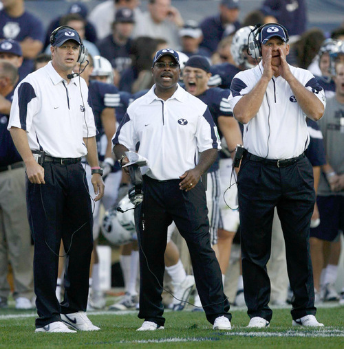 Trent Nelson  |  The Salt Lake TribuneBYU coach Bronco Mendenhall, Jaime Hill, and Paul Tidwell yell out to the BYU defense during the second half, BYU vs. Nevada, college football Saturday, September 25, 2010 at LaVell Edwards Stadium in Provo.