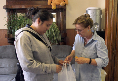 Rick Egan      The Salt Lake Tribune Angela Chacon picks up diapers for her 3-day-old baby at the Crossroads Urban Center in Salt Lake City on Monday. Rachel Fischbein, right, is the emergency services director at the Crossroads Urban Center, which has a free food pantry that also distributes diapers.