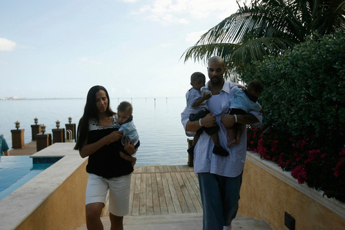 Chris Detrick     The Salt Lake Tribune CeCe Boozer, left, and Carlos Boozer with their children at their home in Miami in 2007.