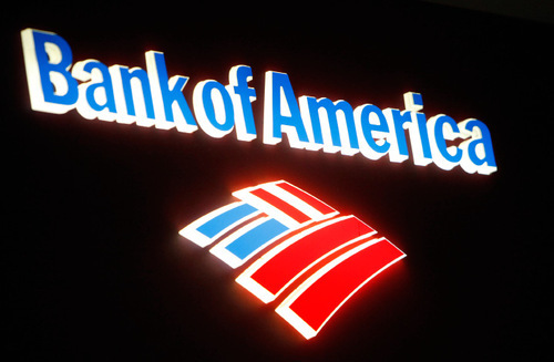 An illuminated Bank of America sign atop an ATM machine is displayed at the bank in downtown Los Angeles on Friday Oct.8,2010. Bank of America Corp., the nation's largest bank, said Friday it would stop sales of foreclosed homes in all 50 states as it reviews potential flaws in foreclosure documents. (AP Photo/Richard Vogel)