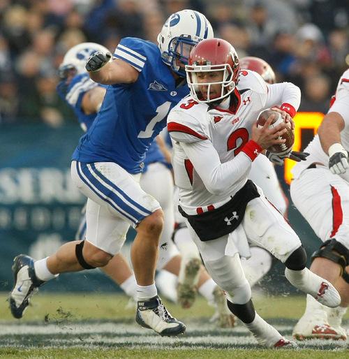 Chris Detrick | The Salt Lake TribuneUtah quarterback Jordan Wynn (3) is sacked byBYU linebacker Jordan Pendleton (1) during the second quarter of the BYU Utah game at Lavell Edwards Stadium in Provo, Utah, Saturday, November 28, 2009.