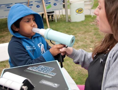 Michael Mangum  |  The Salt Lake Tribune Nicky Garcia of Intermountain Allergy & Asthma administers a test to Ashik Rashid, 5, of Rose Park, during a health fair at Day-Riverside Library in Salt Lake City on Saturday, October 9, 2010. The fair was was intended to raise awareness of potential environmental health issues in the Rose Park and Glendale areas and to kick off a children's health and justice initiative.