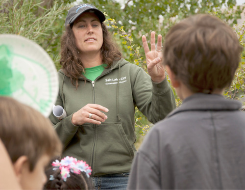 Michael Mangum  |  The Salt Lake Tribune Emy Maloutas, Salt Lake's Open Space Lands Program director, discusses with kids the three ways that seeds are spread during a nature walk at a health fair held at Day-Riverside Library in Salt Lake City on Saturday, October 9, 2010. The fair was was intended to raise awareness of potential environmental health issues in the Rose Park and Glendale areas and to kick off a children's health and justice initiative.