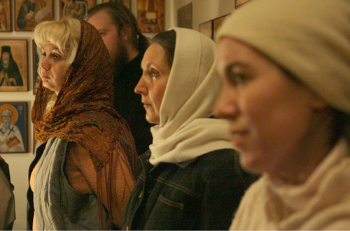 Women cover their heads out of respect during evening service in Utah's first Russian Orthodox Church Jan. 17, 2005.Stephen Holt 1/17/06