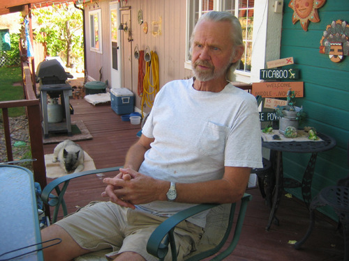 JUDY FAHYS | The Salt Lake TribuneJim Bell and Moki, his dog, enjoy their porch. Bell says high energy and water prices charged by Uranium One, which owns the Ticaboo town site, are a source of aggravation for residents.