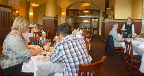 Paul Fraughton  |  The Salt Lake Tribune      Servers attend to patrons in Christopher's dining room in downtown Salt Lake City.