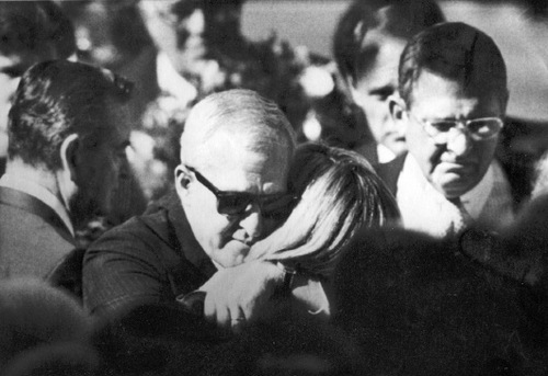 FILE  |  The Salt Lake Tribune Terri Christensen, right center, is embraced by Gary Sheets at the funeral of Christensesn's husband, Steven. Steven Christensen was killed by a bomb blast in his downtown Salt Lake City office. Gary Sheets' wife, Kathy, died in a bomb hours later when she picked up a box police think was intended for Gary.