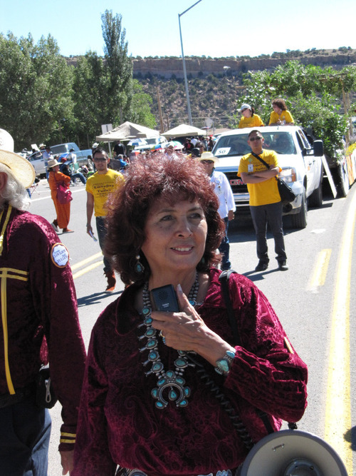 Lynda Lovejoy makes her way through the Navajo Nation Fair parade on Sept. 11, 2010 in Window Rock, Ariz. Lovejoy is seeking to become the tribe's first female president. (AP Photo/Felicia Fonseca)
