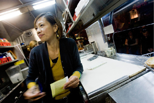 Djamila Grossman  |  The Salt Lake Tribune  SuAn Chow works in her Chow Truck, which is parked in front of Ken Sanders Rare Books store in Salt Lake City, Friday, Oct. 15, 2010.   Chow has successfully pushed the city into writing new rules for food trucks.