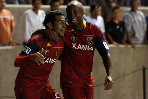 Chris Detrick  |  The Salt Lake Tribune Real Salt Lake forward Paulo Araujo Junior #23 and Real Salt Lake midfielder Collen Warner #26 celebrate after Junior after scoring a goal during the first half of the game at Rio Tinto Stadium Tuesday October 19, 2010.  Real Salt Lake is winning the game 1-0.