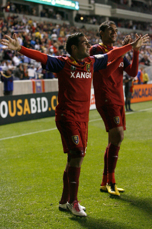 Chris Detrick  |  The Salt Lake Tribune Real Salt Lake forward Paulo Araujo Junior #23 celebrates after scoring a goal during the first half of the game at Rio Tinto Stadium Tuesday October 19, 2010.  Real Salt Lake is winning the game 1-0. Real Salt Lake forward Pablo Campos #19 is in the background.