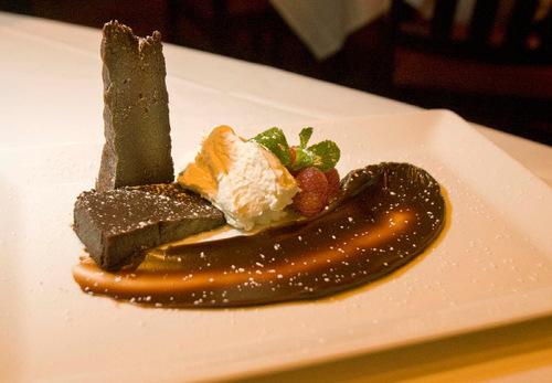 Paul Fraughton  |  The Salt Lake Tribune      Chocolate Naughty Cake, a favorite dessert at Spencer's in Salt Lake City.