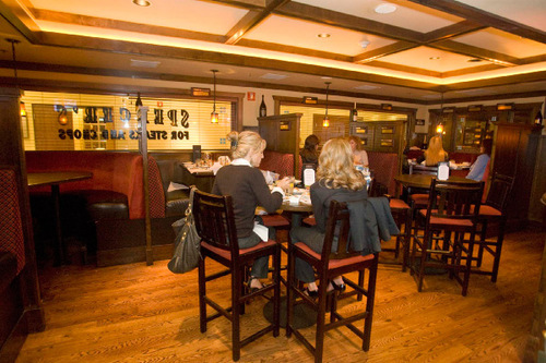 Paul Fraughton  |  The Salt Lake Tribune      Patrons gather in the casual confines of the  bar at Spencer's in Salt Lake City's Hilton Hotel.