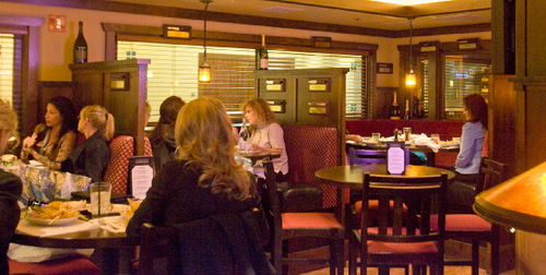 Paul Fraughton  |  The Salt Lake Tribune      Patrons gather in the casual bar at Spencer's in Salt Lake City's Hilton Hotel.