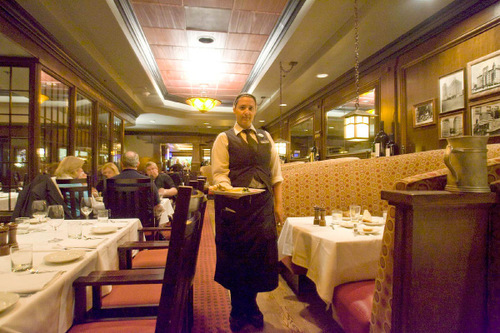 Paul Fraughton  |  The Salt Lake Tribune    A server brings an appetizer  to a table at Spencer's in Salt Lake City's Hilton Hotel.