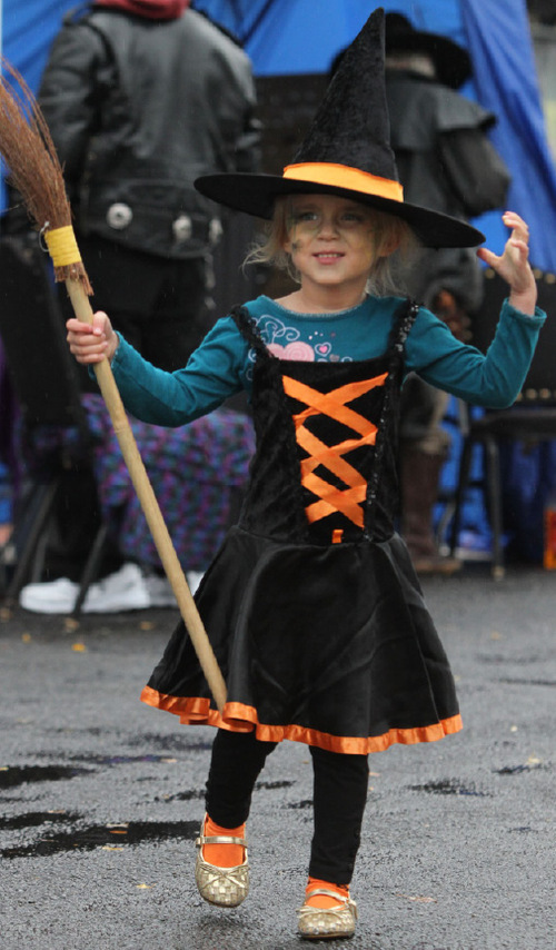 Rick Egan   |  The Salt Lake Tribune Four-year-old Anika Ballard, Ogden, walks with her broom, at the Witchstock  festival on Historic 25th Street in Ogden, Saturday, Oct. 23, 2010.