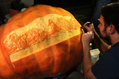 Rick Egan   |  The Salt Lake Tribune Adam Smith, Roy, carves The Last Supper on a 483 lb pumpkin, at the Witchstock festival on Historic 25th Street in Ogden, Saturday, Oct. 23, 2010.