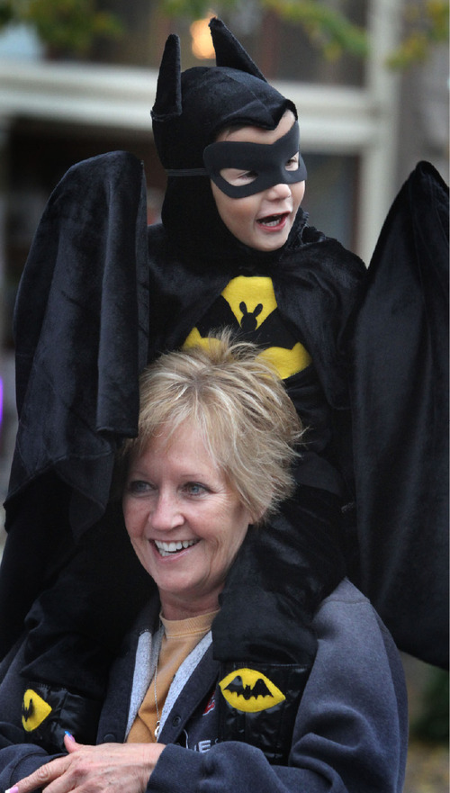 Rick Egan   |  The Salt Lake Tribune Four-year-old Kaestin Smith rides on his grandma, Sherrie Bockas' shoulders, at the Witchstock festival on Historic 25th Street in Ogden, Saturday, Oct. 23, 2010.