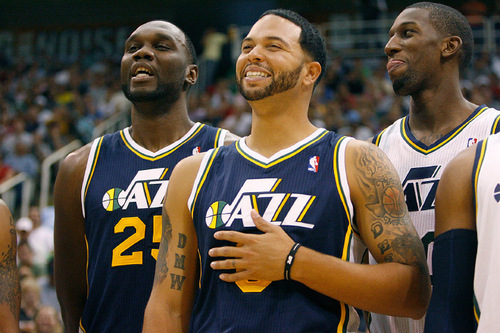 Scott Sommerdorf  l  The Salt Lake Tribune Al Jefferson (25), Deron Williams (8), and Jeremy Evans (right) laugh during introductions prior to a public scrimmage at Energy Solutions Arena on Oct. 2. Williams will be the undisputed leader of the team.