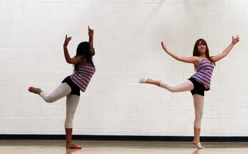 Rick Egan   |  The Salt Lake Tribune Andrea Campbell, 14, and Gabby Balderrama, 14, practice dancing earlier this month at the nonprofit Boys and Girls Club in Midvale. Due to financial woes, as many as a third of Utah's non-profits are at risk of shutting down in the near future, according to a recent study by Wells Fargo and the Community Foundation of Utah.