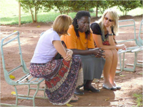 Credit: Judy Dushku Utahns Linda Sullivan, left, and Jacque Poore, right, talk with Lina Zedriga of Uganda about how to set up programs to help young people heal from the wounds and trauma of civil war.