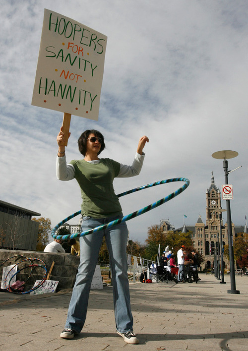 Rick Egan   |  The Salt Lake Tribune Traci Hawk holds a sign as she hoola-hoops,  at Library Square for the Salt Lake Satellite Rally, for the Rally to Restore Sanity vs. March to Keep Fear Alive, Saturday, October 30, 2010.