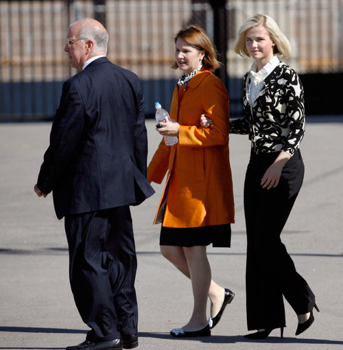 Steve Grifffin  |  The Salt Lake Tribune  Elizabeth Smart, right, leaves the Federal Courthouse on the arm of her mother, Lois Smart, in Salt Lake City on Thursday, Oct. 1, 2009.  Smart testified for the first time about her 2002 abduction and nine months of captivity at the hands of Brian David Mitchell, in a larger hearing on whether Mitchell was mentally competent to stand trial in her kidnapping.