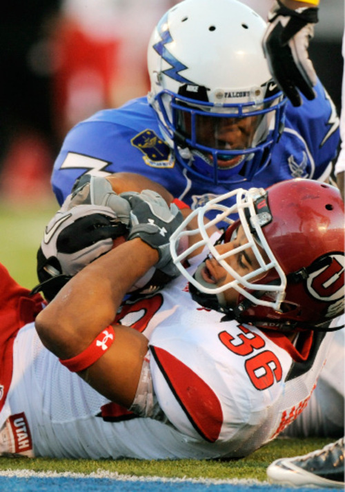 Utah running back Eddie Wide is stopped just short of a touchdown by Air Force's Jon Davis in the first quarter of a NCAA college football game, Saturday, Oct. 30, 2010, at Falcon Stadium in Colorado Springs, Colo. Utah scored on the next play. (AP Photo/Chris Schneider)