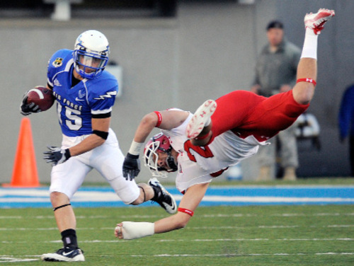Air Force's Zach Kauth, left, returns the opening kickoff as Utah's Brian Blechen is upended in the first quarter of a NCAA College football game, Saturday, Oct. 30, 2010, at Falcon Stadium in Colorado Springs, Colo.. (AP Photo/Chris Schneider)