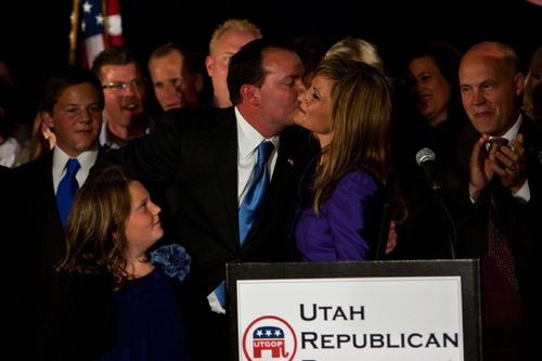 Chris Detrick     The Salt Lake Tribune Surrounded by family, friends and supporters, Republican Mike Lee kisses his wife Sharon at the Salt Lake Hilton Hotel Tuesday November 2, 2010.  Conservative Republican Mike Lee coasted to an easy win Tuesday over Democrat Sam Granato in Utah's Senate race -- shifting Utah's representation in Congress even further to the right, and completing a big victory for the tea party nationally.