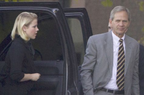 Jim Urquhart | The Associated Press Elizabeth Smart, left, and her father, Ed Smart, arrive at the Frank E. Moss Federal Courthouse Thursday, Nov. 4, 2010, in Salt Lake City. Brian David Mitchell's trial on kidnapping and unlawful transportation of a minor charges began Monday in Salt Lake City's U.S. District Court.