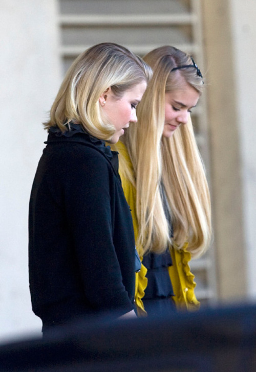 Al Hartmann  |  The Salt Lake Tribune   Elizabeth Smart, left,  and younger sister Mary Katherine Smart, leave from the back door of Frank Moss Federal Courthouse in Salt Lake City on Thursday, Nov. 4.  The trial against Elizabeth Smart's accused kidnapper Brian David Mitchell was stopped after about two hours.