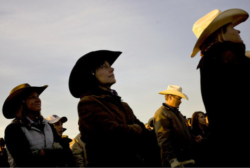 Djamila Grossman  |  The Salt Lake TribuneRiders listen to safety instructions as the sun rises above the mountains before the 24th annual bison roundup on Antelope Island, Friday, October 29, 2010.