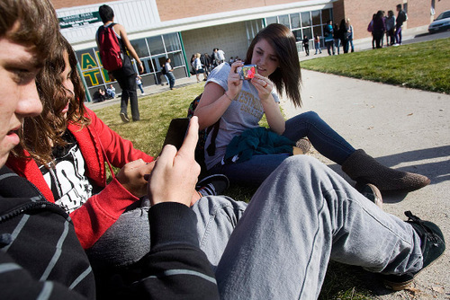 Djamila Grossman  |  The Salt Lake Tribune  From left: Kearns High School sophomores Ethan Co and Alexis Medina, and senior Sierra Co check out the iPod Touch they received along with other students at the school in Kearns, Friday, November 5, 2010. The iPods are part of an educational grant the school has received and they will be used in class.