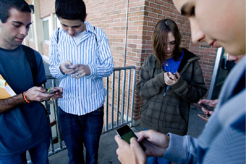 Djamila Grossman  |  The Salt Lake TribuneFrom left: Kearns High School sophomores Andrew Dutson, Rafael Rivas, Kayla Tomascewski and Sage Cordova check out the iPod Touch they received along with other students at the school in Kearns, Friday, November 5, 2010. The iPods are part of an educational grant the school has received and they will be used in class.
