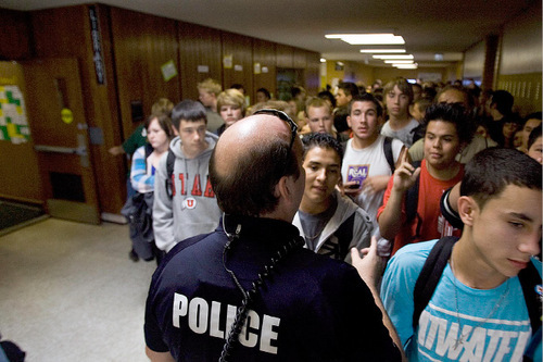 Djamila Grossman  |  The Salt Lake TribuneUnified Police Department officer James Timpson directs Kearns High School students standing in line to receive an iPod Touch handed out at the school in Kearns, Friday, November 5, 2010. The iPods are part of an educational grant the school has received and they will be used in class.