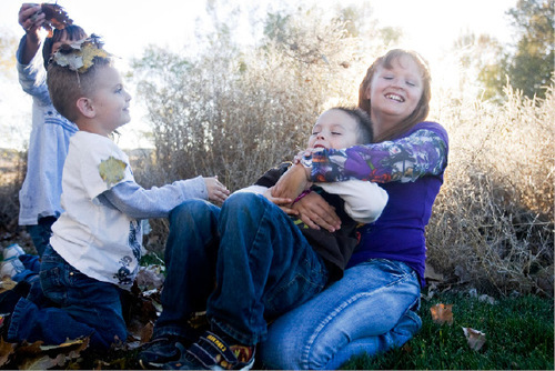 Djamila Grossman  |  The Salt Lake Tribune  Kylie Chambers, 11, plays with her brothers Kason Kirkwood, 4, and Dominick Kirkwood, 5, at their family's Wellington home on  Thursday. Kylie is on the Children's Health Insurance Program. Recent changes in the program have forced Kylie's parents to drive more than 60 miles for their daughter to see a doctor.