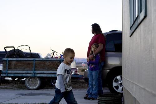 Djamila Grossman  |  The Salt Lake TribuneJason Chambers stands outside his Wellington home with his daughter Chelsey Chambers, 8, and grandson Kason Kirkwood, 4,  Thursday, November 4, 2010.