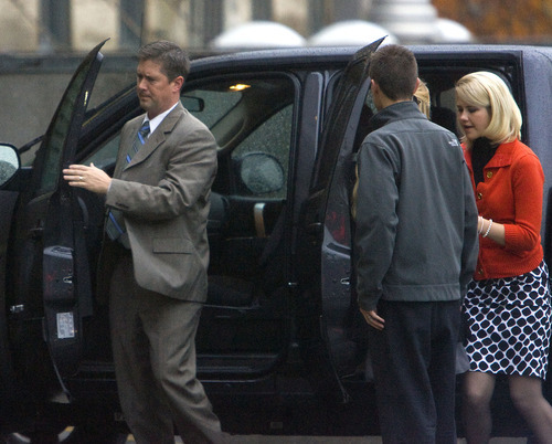 Al Hartmann  |  The Salt Lake Tribune Elizabeth Smart, right, is escorted into Frank Moss Federal Courthouse in Salt Lake City on Monday morning by federal security personnel as the trial against her alleged kidnapper, Brian David Mitchell, resumes.