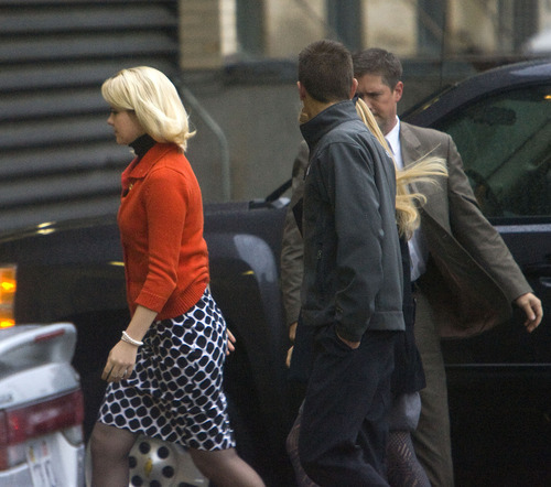 Al Hartmann  |  The Salt Lake Tribune Elizabeth Smart, left, is escorted into Frank Moss Federal Courthouse in Salt Lake City on Monday morning as the trial against her alleged kidnapper, Brian David Mitchell, resumes.