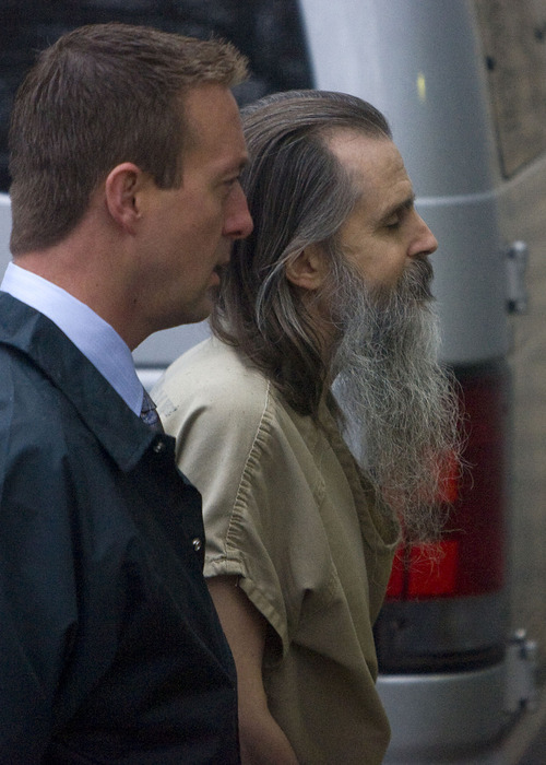 Al Hartmann  |  The Salt Lake Tribune Brian David Mitchell, right, is lead into Frank Moss Federal Courthouse in Salt Lake City on Monday morning by a federal marshall as his trial in the kidnapping of Elizabeth Smart resumes.