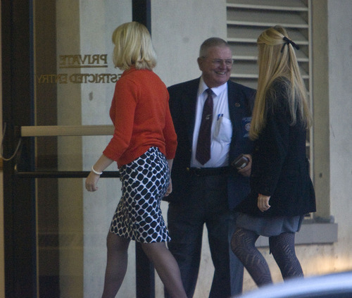 Al Hartmann  |  The Salt Lake Tribune Elizabeth Smart, left, and her younger sister Mary Katherine are escorted into Frank Moss Federal Courthouse in Salt Lake City to resume the Brian David Mitchell trial on Monday, Nov. 8.