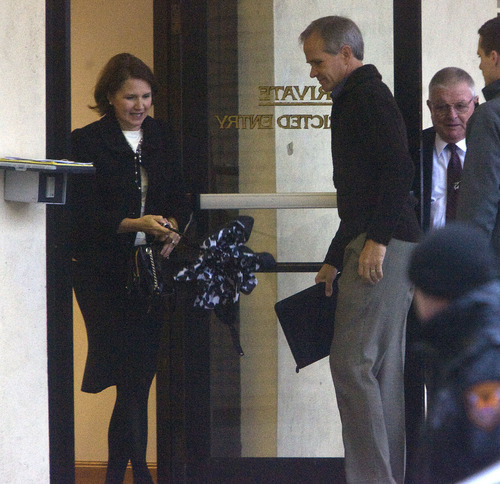 Al Hartmann  |  The Salt Lake Tribune Lois Smart, left, and Ed Smart enter the back door of the  Frank Moss Federal Courthouse in Salt Lake City on Monday morning to resume the Brian David Mitchell trial. He is accused of kidnapping their daughter, Elizabeth Smart.