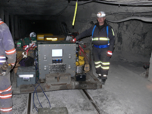 Photo courtsey of Lockheed MartinDave LeVan, an engineer with Lockheed Martin, stands in a coal-mine tunnel next to an explosive-proof structure housing the MagneLink Magnetic Communications System, the company's proposal for providing through-the-ground communications that could help rescuers locate miners trapped deep underground by a fire, explosion or massive roof fall.