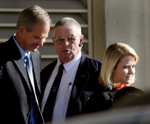 Steve Griffin  |  The Salt Lake Tribune  Elizabeth Smart and her father Ed Smart leave through the back entrance of the Frank E. Moss Federal Courthouse in Salt Lake City on Tuesday, Nov. 9, 2010 after the second day of the trial for Elizabeth's suspected kidnapper, Brian David Mitchell.