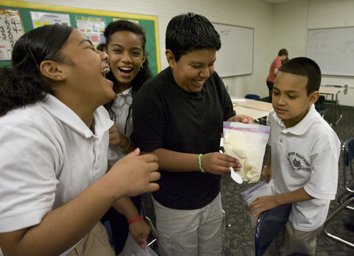 Steve Griffin  |  The Salt Lake Tribune  Twenty chemical engineers from across the United States visited Bryant Middle School in Salt Lake City, to talk to students about careers in chemical engineering and perform experiments. Here seventh graders laugh as classmate, Daniel Meza, center,  gets ready to eat ice cream the students made in plastic bags with ice and rock salt. The engineers are in Salt Lake City for the annual conference of the American Institute of Chemical Engineers in  Salt Lake City Monday, November 8, 2010.