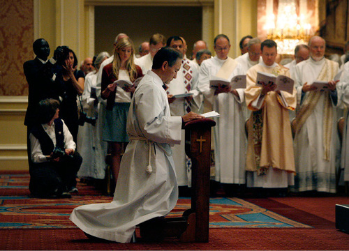 Scott Sommerdorf  l  The Salt Lake Tribune  The Reverend Canon Scott Byron Hayashi kneels during his ordination. The Ordination and Consecration of Hayashi as the 11th bishop of The Episcopal Diocese of Utah, took place Saturday, Nov. 6, 2010.
