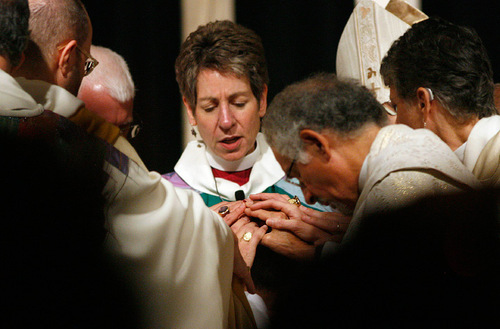 Scott Sommerdorf  l  The Salt Lake Tribune The Presiding Bishop and Primate of The Episcopal Church, The MOst Reverend Dr. Katharine Schori, along wth the other Bishops, lay their hands upon the head of Rev. Scott Hayashi during the Consecration.  The Ordination and Consecration of The Reverend Canon Scott Byron Hayashi as the Eleventh Bishop Diocesan of The Episcopal Diocese of Utah, Saturday, 11/6/2010.