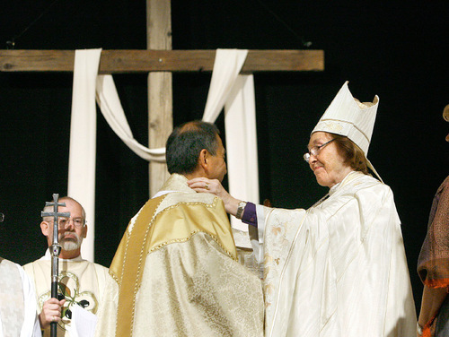 Scott Sommerdorf  l  The Salt Lake Tribune  The Tenth Bishop of the Episcopal Diocese of Utah, Carolyn Tanner Irish congratulates Bishop Scott Hayashi on Saturday after she handed off the staff that represents the position she passed on to him.
