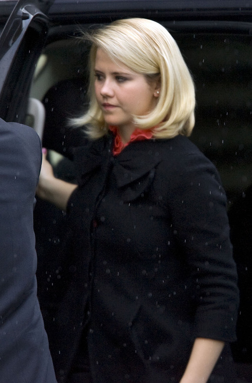 Al Hartmann  |  The Salt Lake Tribune Elizabeth Smart is escorted into Frank Moss Federal Courthouse in Salt Lake City to testify in the Brian David Mitchell trial on Tuesday, Nov. 9.